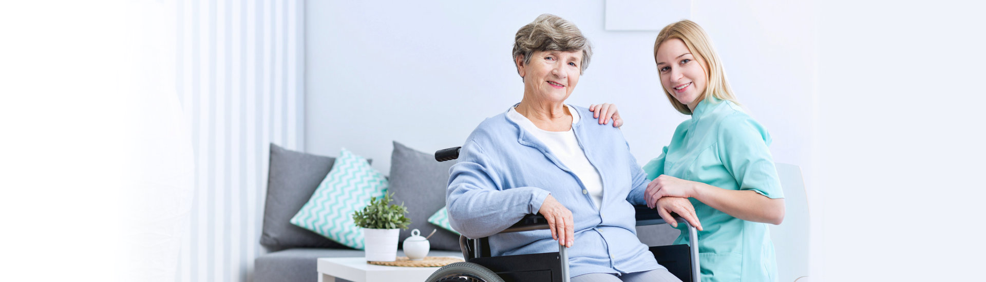 caregiver and elderly woman in a wheelchair | Home Health Care Service Lowell MA